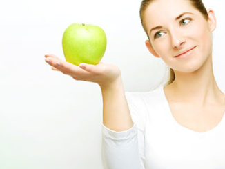 Woman Holding an Apple and Donut Epigenetics
