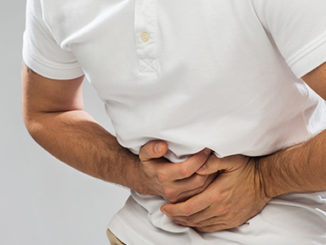 person holding stomach in pain epigenetics