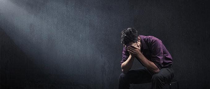 Man Holding Head Sad Depressed Epigenetics