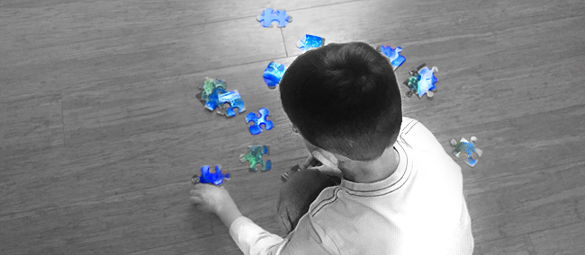 Child Playing With Puzzle Pieces Epigenetics