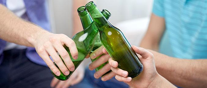 Three people holding beer bottles cheersing epigenetics